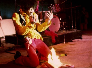 Jimi Hendrix Burning His Guitar on Stage